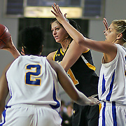 Towson Forward (#11) Doville Millauskaite attempts a pass to her teammate in first half, as Delle Donne (#11) and Bailey (#2) apply defensive pressure. Delaware defeated Towson 75-57 Wednesday at The Bob Carpenter Center In Newark Delaware...Special to The News Journal/SAQUAN STIMPSON