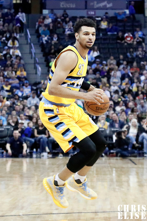 04 March 2017: Denver Nuggets guard Jamal Murray (27) dribbles during the Charlotte Hornets 112-102 victory over the Denver Nuggets, at the Pepsi Center, Denver, Colorado, USA.