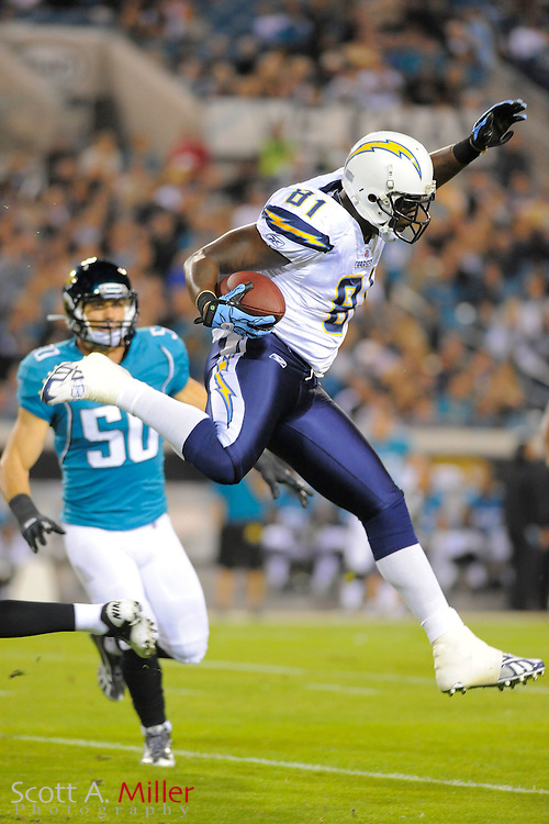 San Diego Chargers tight end Randy McMichael (81) leaps over Jacksonville Jaguars defensive back Kevin Rutland (22) as he runs upfield during the first half  of their NFL game at EverBank Field on Dec. 5, 2011 in Tampa, Fla. .©2011 Scott A. Miller