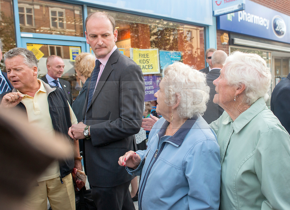 © Licensed to London News Pictures. 29/08/2014. Clacton-on-Sea, UK Douglas Carswell (L) and Nigel Farage (not pictured), Leader of the UK Independence Party, UKIP, meet local people on a walk about in Clacton-on-Sea today 29th August 2014. Tory Douglas Carswell  defected to UKIP and quit as MP for Clacton, saying he will contest the subsequent by-election for Nigel Farage's party.. Photo credit : Stephen Simpson/LNP