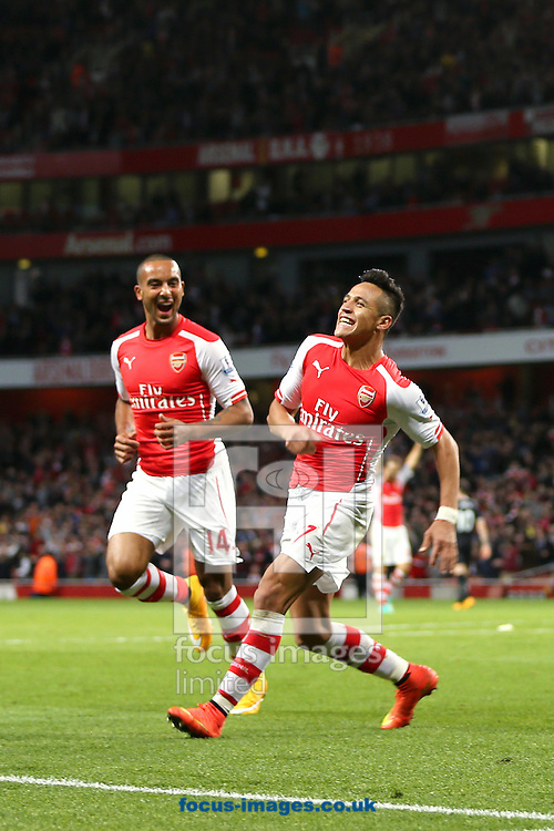 Alexis Sanchez (right) of Arsenal celebrates with team mate, Theo Walcott (left) after scoring the third goal of the Barclays Premier League match against Burnley at the Emirates Stadium, London<br /> Picture by Richard Calver/Focus Images Ltd +447792 981244<br /> 01/11/2014