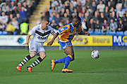 Carl Dickinson of Port Vale FC closes down Sullay Kaikai of Shrewsbury Town (on loan from Crystal Palace) during the Sky Bet League 1 match between Shrewsbury Town and Port Vale at Greenhous Meadow, Shrewsbury, England on 25 March 2016. Photo by Mike Sheridan.