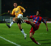 Photo. Daniel Hambury.<br /> UEFA Cup.<br /> Panionios V Newcastle United. 21/10/2004.<br /> Panionios' Spiropoulos and Newcastle's James Milner