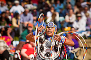 06 FEBRUARY 2011 - PHOENIX, AZ: ALLENROY PAQUIN, a Ticaricca Apache, performs at the 21st Annual Heard Museum World Championship Hoop Dance Contest at the Heard Museum in Phoenix, AZ, Sunday, February 6. Hoop dancing has a long tradition among Native American peoples. The hoop or circle is symbolic to most Native people. It represents the Circle of Life and the continuous cycle of summer and winter, day and night, male and female. Some native people use hoop dancing as a part of healing ceremonies designed to restore balance and harmony in the world.      Photo by Jack Kurtz