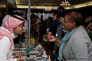 UD masters student Naif Alammag (left) talks with Nadine Feast of Dayton during the University of Dayton International Festival in UD's Kennedy Union Ballroom in Dayton, Saturday, March 24, 2012.  Feast says she's 'very interested in other cultures.'