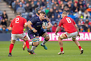 Magnus Bradbury (#6)of Scotland runs at Ken Owens (#2) of Wales and Ross Moriarty (#8) of Wales during the Guinness Six Nations match between Scotland and Wales at BT Murrayfield Stadium, Edinburgh, Scotland on 9 March 2019.