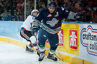 KELOWNA, CANADA -FEBRUARY 10: Adam Henry #4 of the Seattle Thunderbirds skates for the puck against the Kelowna Rockets on February 10, 2014 at Prospera Place in Kelowna, British Columbia, Canada.   (Photo by Marissa Baecker/Getty Images)  *** Local Caption *** Adam Henry;