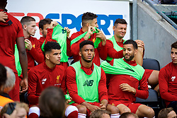 WIGAN, ENGLAND - Friday, July 14, 2017: Liverpool's substitutes Dominic Solanke, Joe Gomez and Kevin Stewart on the bench before a preseason friendly match against Wigan Athletic at the DW Stadium. (Pic by David Rawcliffe/Propaganda)