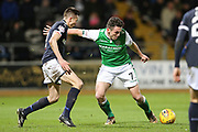 John McGinn (#7) of Hibernian holds off the challenge of Cammy Kerr (#2) of Dundee before slotting the ball in the corner of the net to score Hibernian's first goal (1-0) during the Ladbrokes Scottish Premiership match between Dundee and Hibernian at Dens Park, Dundee, Scotland on 24 January 2018. Photo by Craig Doyle.