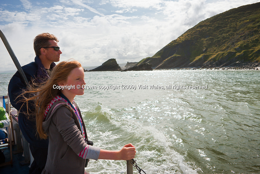 Father and daughter looking out to sea<br /> Near New Quay<br /> Ceredigion Heritage Coast<br /> Mid Wales<br /> Dolphin watching<br /> Activities And Sports