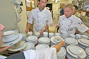 Farewell Gala Dinner aboard the Sea Cloud. Chef de Cuisine Eva Eppard preparing the white tomato soup with basil croutons.