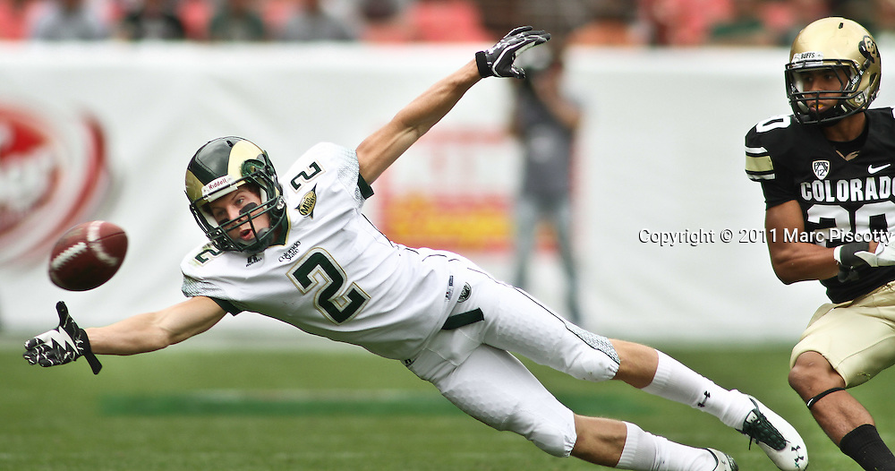 SHOT 9/17/11 1:42:55 PM - Colorado State's Thomas Coffman #2 dives for a pass in front of Colorado's Greg Henderson #20 during the Mile High Showdown game at Sports Authority Field at Mile High Stadium. Colorado won the in-state rivalry game 28-14. (Photo by Marc Piscotty /  © 2011)