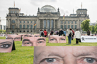 """28 JUN 2013, BERLIN/GERMANY:<br /> Im Rahmen der ONE-Kampagne """"Ich schaue hin!"""" stehen 140 Tafeln mit Augenpaaren von Unterstützern auf dem Platz der Republik. Damit soll erreicht werden, dass Entwicklungspolitik auch im Wahlkampfsommer im Blickpunkt bleibt und dass Wähler darauf achten, dass die Politik ihre Versprechen zur Entwicklungshilfe haelt. Im Hintergrund das Reichstagsgebaeude.<br /> ONE ist eine überparteiliche und international agierende Lobby- und Kampagnenorganisation, die sich für die Bekämpfung extremer Armut und vermeidbarer Krankheiten einsetzt.<br /> IMAGE: 20130628-01-023"""