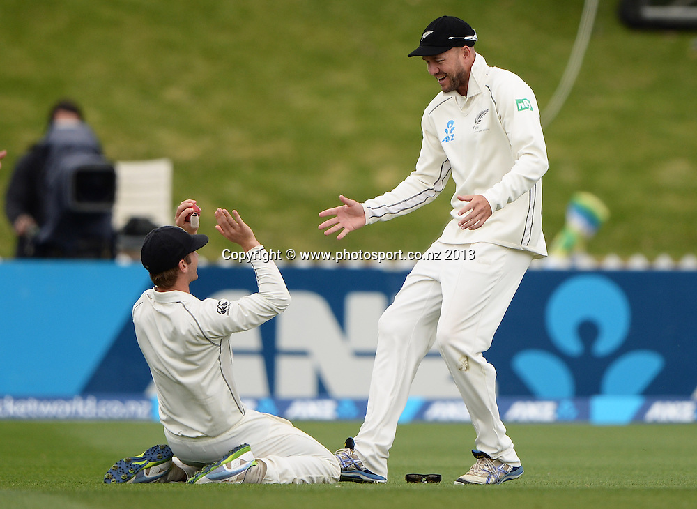 Kane Williamson and Peter Fulton celebrate the dismissal of Kirk Edwards on Day 3 of the 2nd cricket test match of the ANZ Test Series. New Zealand Black Caps v West Indies at The Basin Reserve in Wellington. Friday 13 December 2013. Mandatory Photo Credit: Andrew Cornaga www.Photosport.co.nz
