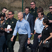 THURSDAY, FEBRUARY 15- 2018---PARKLAND, FLORIDA--<br /> Florida Governor Rick Scott, blue shirt in front, with Broward County Sheriff Scott Israel on their way to a press conference outside Marjory Stoneman Douglass High School one day after a mass shooting with 17 casualties.<br /> (Photo by Angel Valentin/FREELANCE)