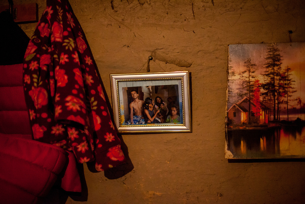 At Ivans (26) home, a photograph from a previous visit exhibited at the Roma settlement in Ostrovany.