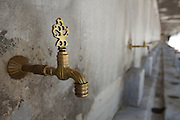 "A row of water faucets at The Sultan Ahmed Mosque or popularly known as ""The Blue Mosque"" for the blue tiles on the walls and ceilings of the enormous mosque completed in 1616 in Istanbul, Turkey.  Photo and all rights reserved, Bryan Rinnert/3Sight Photography."