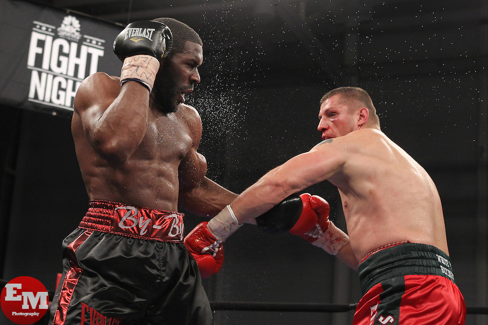 Mar 24; Newark, NJ, USA; Sergei Liakhovich (Red/Green trunks) and Bryant Jennings (Black/Red trunks) trade punches during their 10 round heavyweight bout at the Aviator.