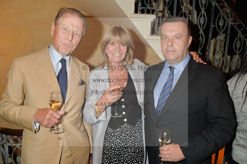 Left to right, EDWARD FOX, INGRID SEWARD and DAVID POGSON of the Buckingham Palace Press Office at The House of Britannia reception hosted by Lady Delves Broughton at 42 Berkeley Square, London on 26th June 2014.