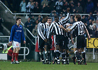 Photo. Glyn Thomas, Digitalsport<br /> Newcastle United v Vålerenga IF.<br /> UEFA Cup Third Round Second Leg.<br /> St James' Park, Newcastle. 03/03/2004.<br /> Newcastle's Shola Ameobi (arm raised) celebrates restoring his side's lead early in the second half while Valerenga's Daniel Fredheim Holm (L) looks on disconsolately.