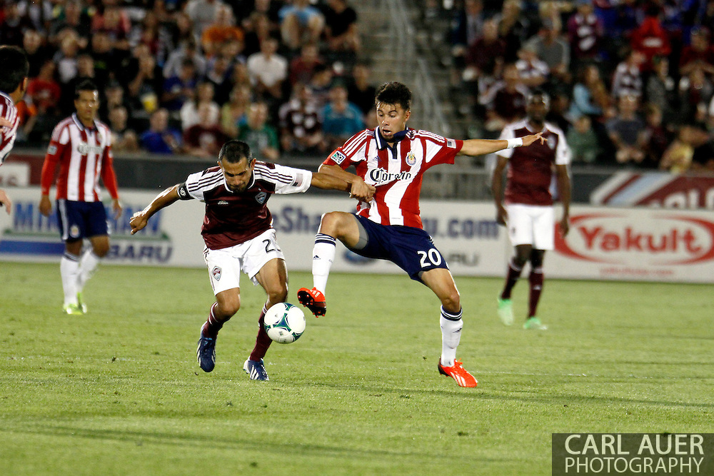 May 25th, 2013 Commerce City, CO - Chivas USA midfielder Carlos Alvarez (20) and Colorado Rapids midfielder Nick LaBrocca (2) fight for control of the ball in the second half of the MLS match between Chivas USA and the Colorado Rapids at Dick's Sporting Goods Park in Commerce City, CO