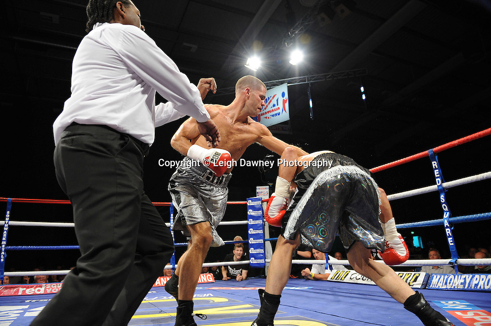 Referee stops the fight and Tony Hill (silver shorts) defeats Paul Samuels at Medway Park, Gillingham, Kent, UK on 13th May 2011. Frank Maloney Promotions. Photo credit © Leigh Dawney 2011.