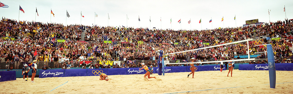 A panoramic image showing the Beach Volleyball Arena at Bondi Beach as Natalie Cook and Kerri Pottharst, Australia, win the Women's Beach Volleyball Gold from Shelda Bede and Adriana Behar  Brazil,  during the 2000 Sydney Olympic Games...Panoramic images from the Sydney Olympic Games, Sydney, Australia.  2000 . Photo Tim Clayton