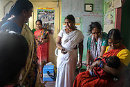 A health worker, centre, speaks to a woman before immunising a child at an Aanganwadi, a government family health centre in Rangsaipet, in Waragal, Telangana, Indiia, on Saturday, February 9, 2019. Photographer: Suzanne Lee for Safe Water Network