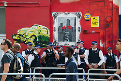 Police working in the streets at the 2013 Notting Hill Carnival in West London, United Kingdom. Monday, 26th August 2013. Picture by Nils Jorgensen / i-Images