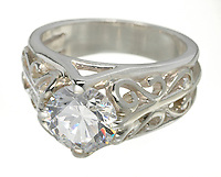 round diamond ring in art deco style mounting on a platinum setting