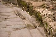 Marks of old wheels in Pompeji, Italy