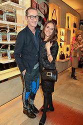 BRUNO FRISONI and AMBRA MEDDA at the Roger Vivier 'The Perfect Pair' Frieze cocktail party celebrating Ambra Medda & 'Miss Viv' at the Roger Vivier Boutique, Sloane Street, London on 15th October 2014.