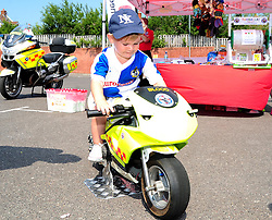 A young Bristol Rovers' fan rides on a blood bike at the fun day - Photo mandatory by-line: Dougie Allward/JMP - Tel: Mobile: 07966 386802 21/07/2013 - SPORT - FOOTBALL - Bristol -  Bristol Rovers Fun Day