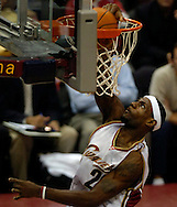 LeBron James slams home an easy basket last night in the first quarter against Denver.