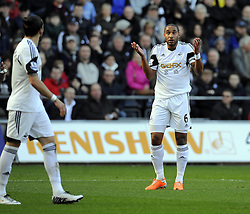 Swansea City's Ashley Williams questions Swansea City's Chico - Photo mandatory by-line: Joe Meredith/JMP - Tel: Mobile: 07966 386802 19/01/2014 - SPORT - FOOTBALL - Liberty Stadium - Swansea - Swansea City v Tottenham Hotspur - Barclays Premier League
