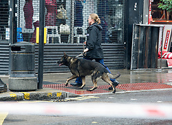 © London News Pictures. 24/08/2013. Kilburn, UK. Police at the scene of a double shooting on Kilburn High Road in North London in which two women were shot. One is serenely in critical condition. Photo credit: Ben Cawthra/LNP