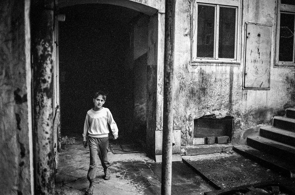 A girl walking in a backyard in Zizkov.