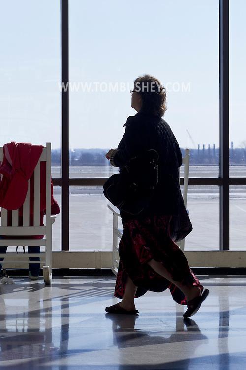 Philadelphia, Pennsylvania - A woman walks past a window at Philadelphia International Airport on Jan. 26, 2013.