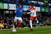 Ryan Williams (7) of Portsmouth battles for possession with Clarke Oduor (22) of Barnsley during the The FA Cup match between Portsmouth and Barnsley at Fratton Park, Portsmouth, England on 25 January 2020.