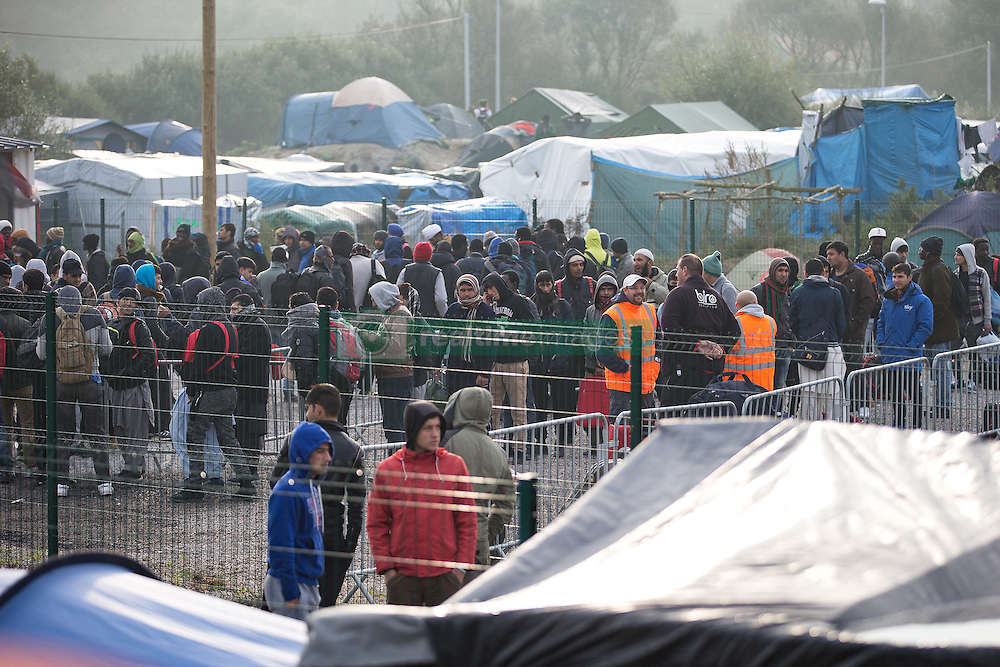 October 24, 2016 - Calais, Calais, France - Calais , France . People queue to leave the Jungle migrant camp in Calais , Northern France , with their parents , on the day of a planned eviction and start of the destruction of the camp  (Credit Image: © Joel Goodman/London News Pictures via ZUMA Wire)