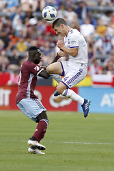 April 29, 2018 - Commerce City, Colorado - Orlando City SC midfielder Will Johnson (4) elevates to head the ball as he collides with Colorado Rapids midfielder Bismark Adjei-Boateng (21) in the second half of action in the MLS soccer game between Orlando City SC and the Colorado Rapids at Dick's Sporting Goods Park in Commerce City, Colorado (Credit Image: © Carl Auer via ZUMA Wire)