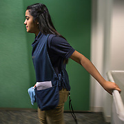 WASHINGTON, DC - DEC 11: Dinia Lovo Marquez, an 18-year-old senior at Bell Multicultural High School in Washington, DC, works as a janitor after school at the U.S. Department of Education, December 11, 2013. An immigrant from El Salvador, she one of 7 children being raised by her mother Maria, a cook at the Willard Hotel. Dinia wants to be the first in her family to attend college. (Photo by Evelyn Hockstein/For The Washington Post)