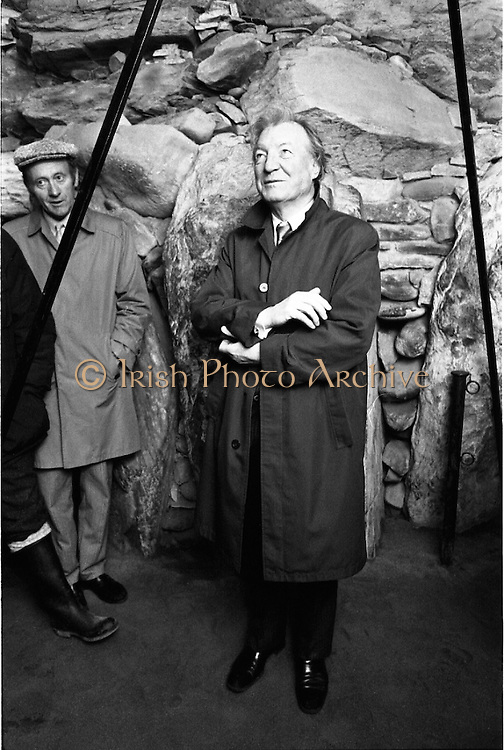 Taoiseach Visits Newgrange.  (R70)..1987..21.12.1987..12.21.1987..21st December 1987..An Taoiseach, Charles Haughey TD, visited the Newgrange Stoneage Chamber to view thwe annual Winter Soltice. As the sun rose, An Taoiseach watched as the sunrise traced its path along the floor of the chamber...Image shows An Taoiseach, Charles Haughey, inside the Stone age chamber waiting for the sunrise to light up the interior during the Winter Solstice.