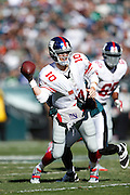 New York Giants quarterback Eli Manning (10) tries to make a throw while under pressure during the NFL week 8 football game against the Philadelphia Eagles on Sunday, Oct. 27, 2013, at Lincoln Financial Field in Philadelphia, Pennsylvania. The Giants won the game 15-7. (Joe Robbins)