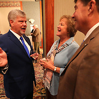 Scott Reed talks with Ann Godwin and David Rumbarger at the Summit in Tupelo Thursday night prior to the roast that honored Reed to raise money for the Antone Tannehill Good Samaritan Free Clinic.
