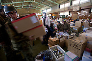 Members of Japan's Self-Defense forces deliver emergency supplies to a shelter in Kamaishi, Iwate Prefecture, Japan on 04 April, 2011. .Photographer: Robert Gilhooly