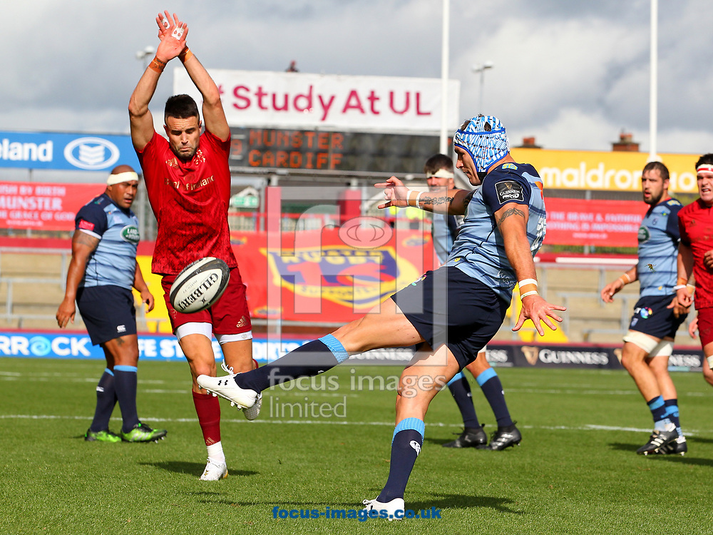 Conor Murray of Munster and Tom James of Cardiff Blues during the Guinness Pro 14 match at Thomond Park, Limerick<br /> Picture by Yannis Halas/Focus Images Ltd +353 8725 82019<br /> 30/09/2017