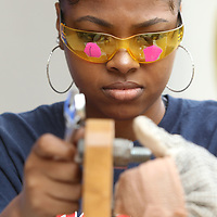 "T'Ajahlon White, 17, a Junior at Nettleton High School, works at the ""Working with Tools"" booth where she uses wrenches, bolts and nuts, to simulate having desensitization in her hands by wearing a glove wrapped in a bandage and wearing glasses that simulate macular degeneration during the Empathy Experience Wednesday at Longtown Medical Park in Tupelo. North Missisippi Medical Center staff as well as Certified Occupational Therapy Assistants students from ICC worked at stations to simulate what it's like to have a disability and how the Occupational Therapists help people overcome handicaps."