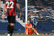 Bournemouth goalkeeper Aaron Ramsdale (12) sits distraught after Bournemouth  are relegated during the Premier League match between Everton and Bournemouth at Goodison Park, Liverpool, England on 26 July 2020.