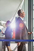 Portrait of Mature businessman boarding on the plane in airport